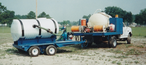 Old photo of NaturChem utility vehicle and sprayer